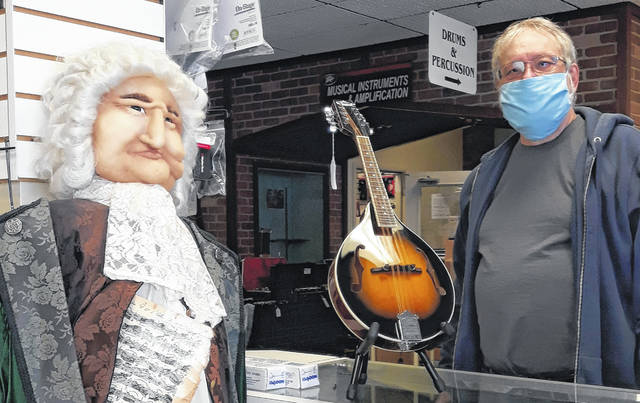 "Bruce Kaiser, owner of Bach to Rock since 1986, with replica of the store's namesake, Johann Sebastian Bach, in the front of the store, located at 334 Broadway in downtown Greenville.	Celebrating its 35th anniversary this year, Bach to Rock has become the ""go to"" store for all things music-related in Darke County."