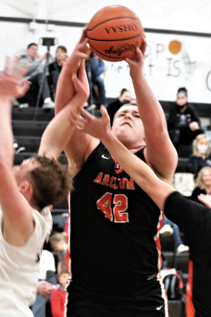 Arcanum's Chase Werling pulls down a rebound in the team's CCC win at Mississinawa Valley.