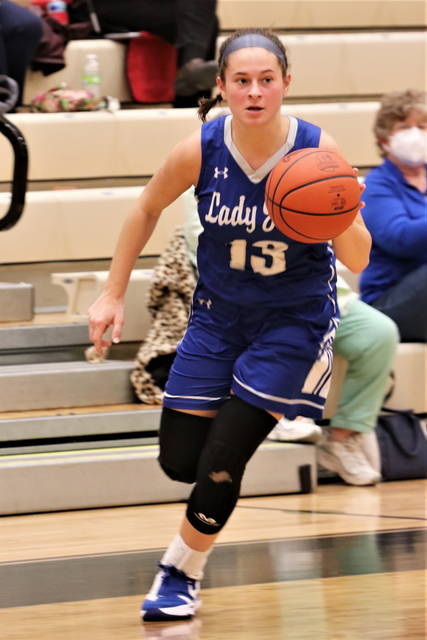 Franklin Monroe senior, Chloe McGlinch drives to the hoop for the Lady Jets in tournament action with the Lady Patriots.