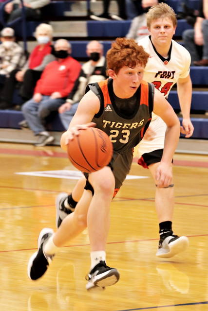Ian Schmitmeyer drives to the hoop for Ansonia in varsity tournament action.