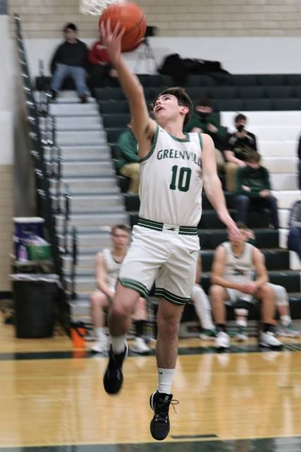 Jace Bunger scores for Greenville in MVL contest with Sidney. Jace Bunger drives to the hoop for Greenville in Wednesday night action with Sidney.