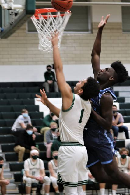 Million Bryant goes to the basket for the Green Wave in MVL action with Fairborn.