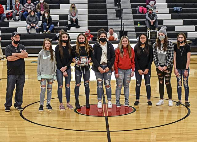 CCC 8th grade championship Lady Blackhawks team are introduced between the Mississinawa Valley JV and Varsity girls basketball game.