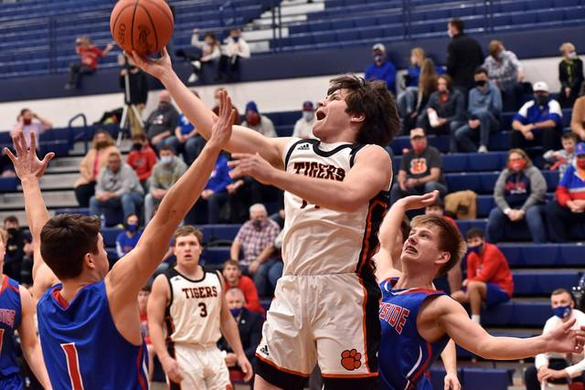 Ansonia's Isaac Barga drives to the basket to help lead the Tigers to a first round tournament win over the Riverside Pirates.