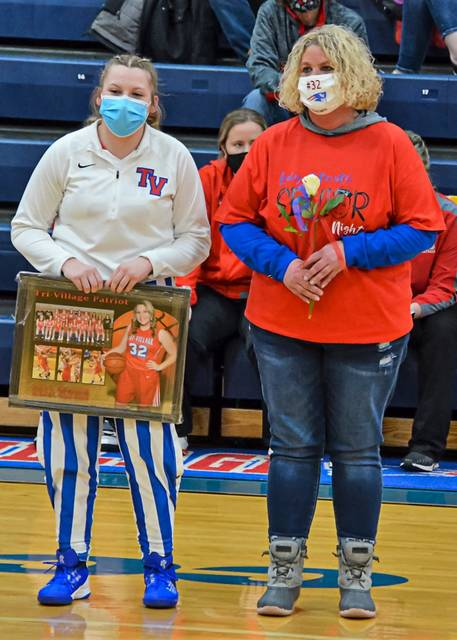 Lady Patriot senior, Karsi Sprowl is honored prior to the team's home game.