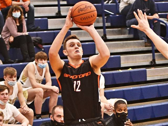 Parler Davidson hits a trey for 3 of his game high 19 points in the Railroaders tournament loss to No. 1 seed and state ranked Botkins.