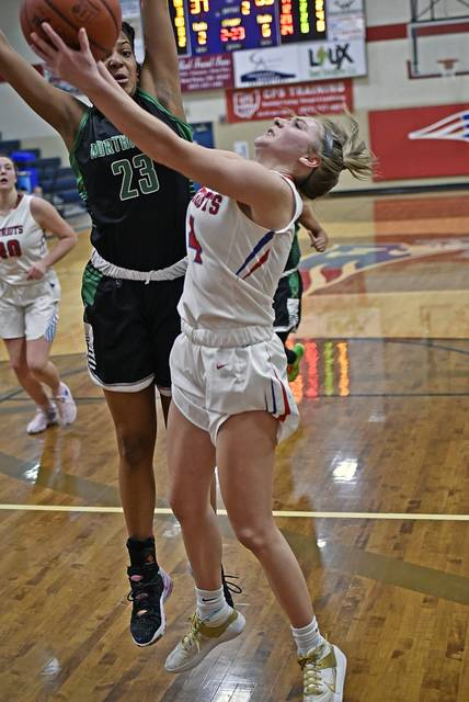 Rylee Sagester drives the lane for Tri-Village in the Lady Patriots non-conference win over Northmont.