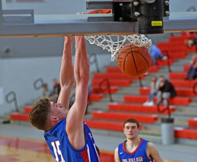 Layne Sarver slams down 2 of his game high 28 points for Tri-Village in the Patriots OHSAA DIV tournament win over Southeastern.