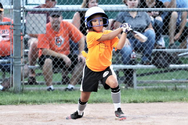 A young softball player gets a hit in the 2020 GGSA Munchkin League championship game at Greenville's Stebbins Field.