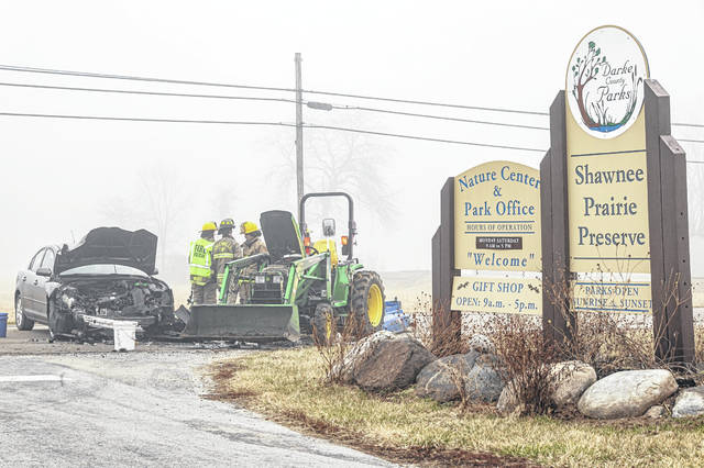 A Darke County Parks District worker was thrown from a tractor following a collision with a car Tuesday morning. Heavy fog is believed to have contributed to the crash.