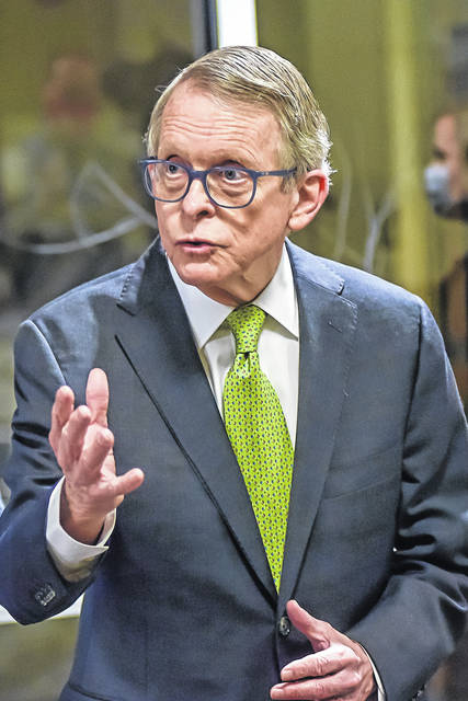 """Gov. Mike DeWine speaks with the press about his visit to Reid Health in Greenville Saturday. He called it """"a very impressive operation."""""""