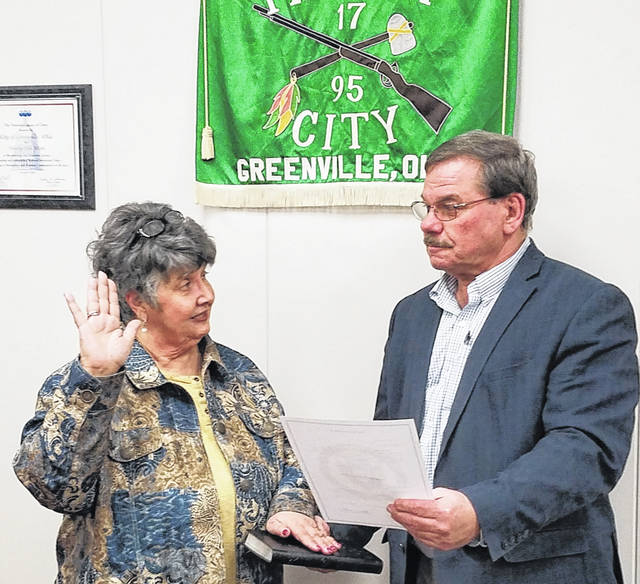 Delores Ely being sworn in as Second Ward Greenville City Councilman by Mayor Steve Willman. Ely, who was appointed by the Darke County Republican Central Committee to fill the unexpired portion of Doris Howdieshell's current term, may be contacted by phone at 937-569-1581 or by email at dely@cityofgreenville.org