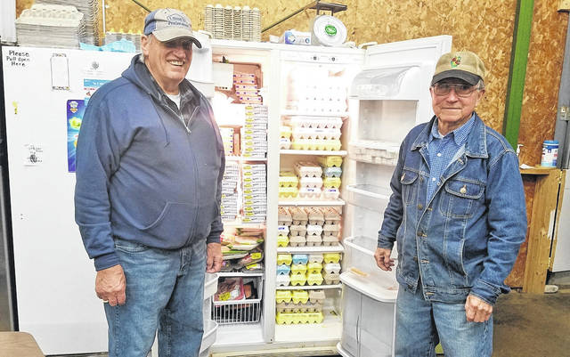 Harold Graham (left), of Greenville, and Russ Marchal, of the Rossburg area, restock food as volunteers at FISH Choice Pantry in Greenville. FISH received funding from the COVID-19 Relief Fund at the Darke County Foundation. Darke County residents, if they are able, are encouraged to donate their stimulus check to this fund that provides local assistance for basic needs.