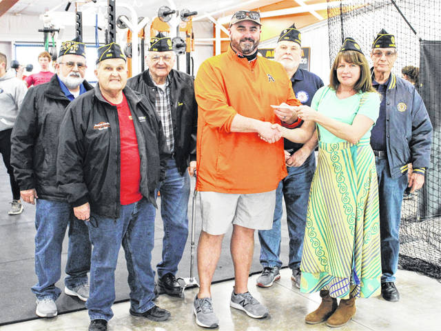 Commander Jen Robertson passes the check to Ansonia Athletic Director Matt Macy. Shown from L to R: Gary Midlam, Russell Midlam, Ivan Christian, Matt Macy, Jim Kammer, Jen Robertson, and Dennis Dickey.