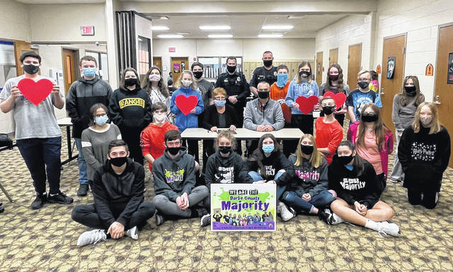 """Arcanum Mayor Bonnie Millard and Arcanum Police Chief Marcus Ballinger visited Arcanum schools on Thursday to sign a proclamation designating """"We are the Majority,"""" week in Arcanum. A number of middle and high school student members attended the signing."""
