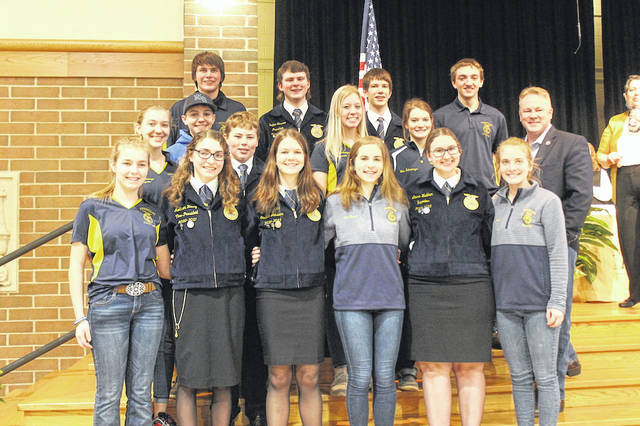 A group of Versailles FFA students with Rep. Davidson. Versailles FFA played a major role in making this event a success and Davidson and other speakers thanked them for their continued efforts to make the event the best it could be.