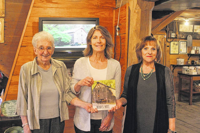 Author Lois Smith (left), Executive Director of the Darke County Foundation Christy Prakel, and author Lin Roberts.