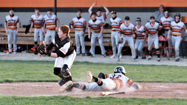 Jaxson Christ slides home with the winning run in Arcanum's win over Versailles.