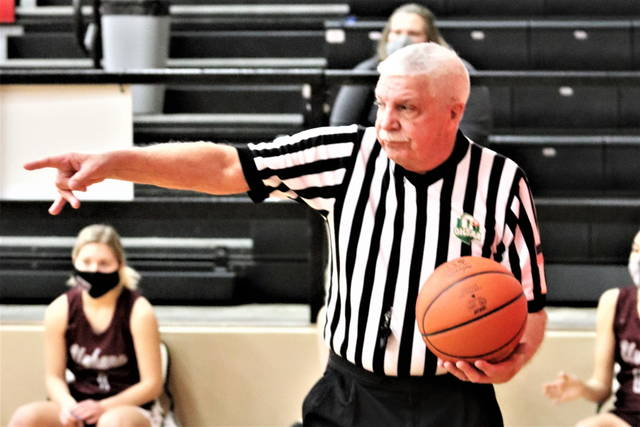Bill Trent makes a call as the OHSAA basketball referee bring his 40 officiating career to a close.