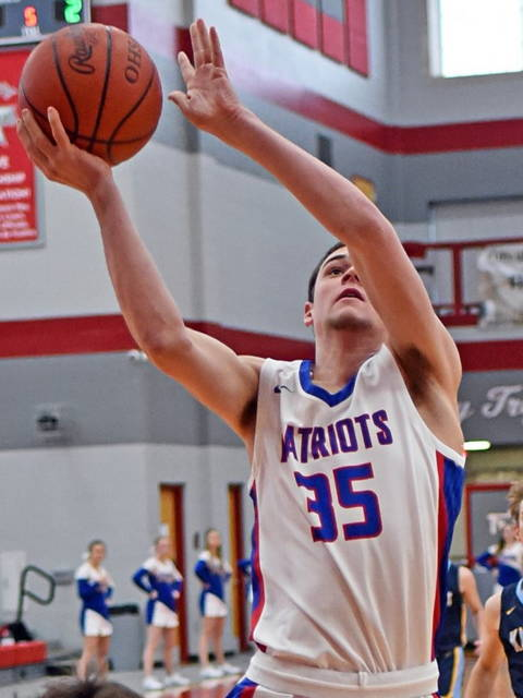 """Tri-Village 6'5"""" sophomore Justin Finkbine scores to lead the Patriots and all scorers with a game high 23 points in the team's tournament win over Legacy Christian."""