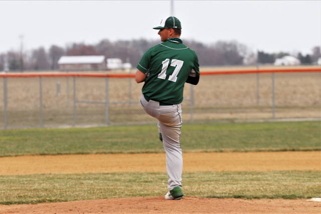 Warren Hartzell pitches for the Green Wave in varsity baseball scrimmage at Arcanum