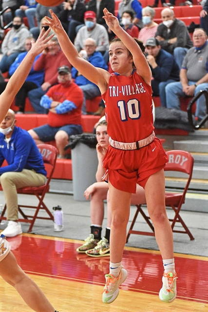 Delanee Gray puts up a trey in the Lady Patriots District Championship win over the Russia Lady Raiders.