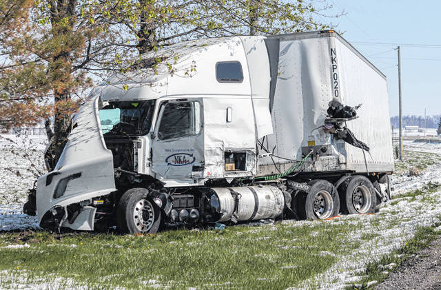 A semi-tractor trailer hit a tree at a residence in York Township Wednesday after colliding head-on with a cargo van that veered left of center. The driver of the van, Yassin Mohamed Ishaq of Kansas City, Mo., was pronounced dead at the scene. The truck driver suffered minor injuries.