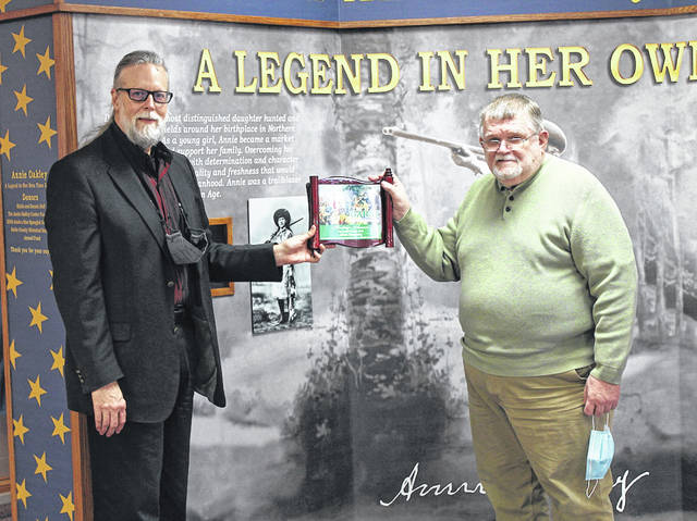 The Darke County Historical Society's 2021 Heritage Award recipient is Allen Hauberg. Allen Hauberg (right) receives the award from Dr. Clay Johnson (left) at Garst Museum.