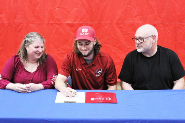 Tri-Village Patriots Aiden Collins signs to play golf at IU East. (L-R) Shannon Collins (mother), Collins, Anthony Collins (father)