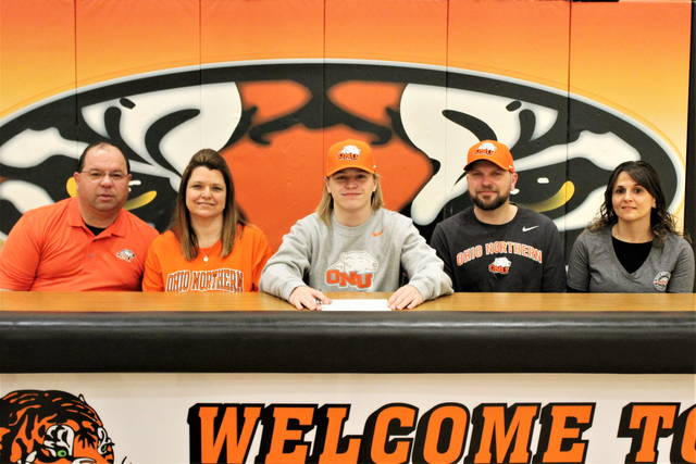 Zach Frazee signs with Ohio Northern University football program. (L-R) Brian Pearson (stepfather), Crystal Buteau (mother), Frazee, Zach Frazee (father), Cortney Frazee (stepmother)