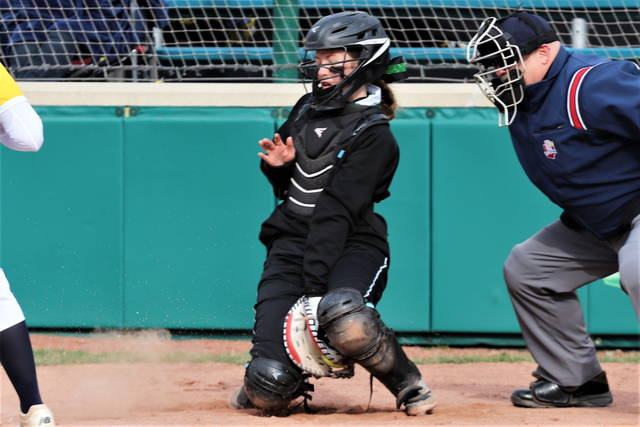 Greenville catcher, Alaina Baughn makes a stop behing the plate in the team's OHSAA win over Springfield.
