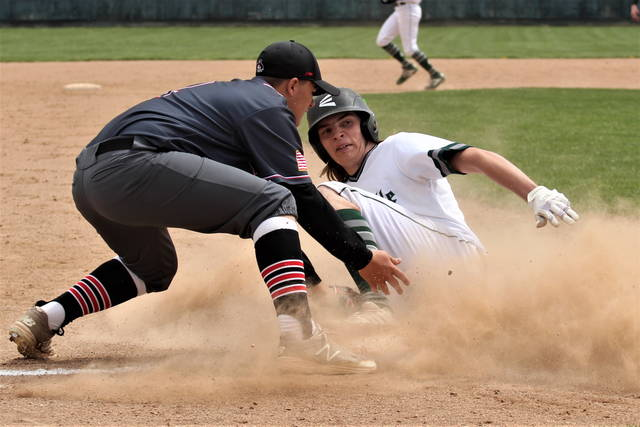 Cameron Fletcher slides hard into third in Greenville's win over the Covington Buccaneers.