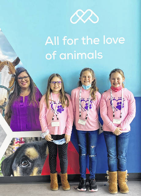 Pets Paws & Claws founders Evelyn, Callie and Jenna, are all smiles while touring Midmark Corp. in Versailles. The Darke County fourth graders established a rescue for unwanted cats and kittens in 2019.