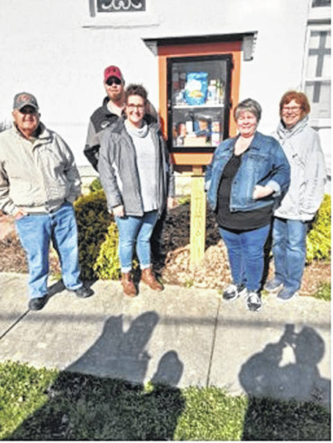 The Outreach Team at Ansonia United Methodist Church created a blessing box for local families in need. Pictured at the dedication of the blessing box are (left to right) Russ Midlam, Mike Gessler, Amy Gessler, Laura Turner, and Beth Campbell.