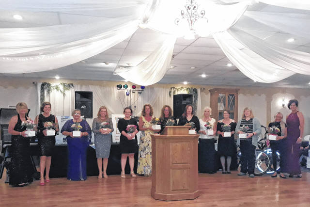 The Red & Yellow, Black & White Gala Committee members (pictured) included Rhonda Albers, Amanda Armstrong, Angie Arnold, Kristene Clark, Sandee Detrick, Kelly Fliehman, Peggy Follrod, Ashley Gilpin, Cindy McCallister, Paula Moody, Stephanie Morgan, Shelby Myers, Kathy O'Dell, and Renee Subler.