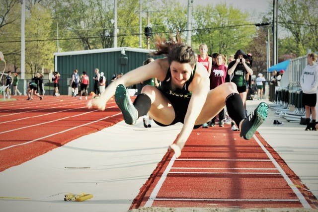 Greenville's Grace Conway earns first place in the women's long jump at the Friday night Salzman Relays.
