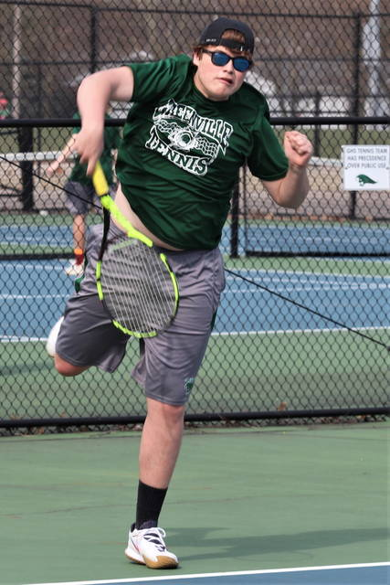 Greenville's Heath Commer wins at first doubles for the Wave.