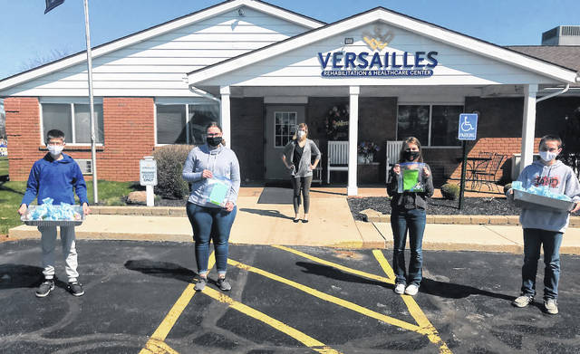 On Monday, March 30 Versailles FFA Students visited the nursing home and delivered Easter cookies, meat and cheese, and Easter themed craft bags for residents to make on their own. Pictured are Versailles FFA Members (left to right) Grifon Miller, Laura Wuebker, Emma Middendorf and Jeremiah Wagner.