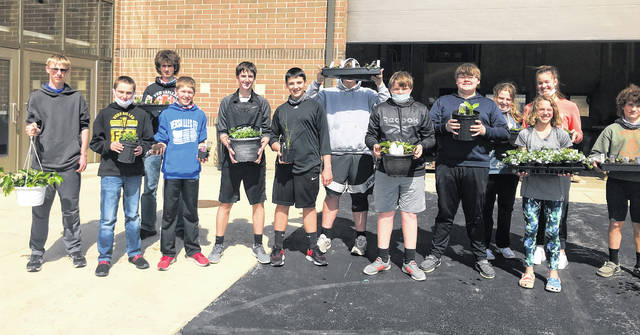 The Versailles Agricultural Education Department and FFA Chapter will conduct its 10th Annual Greenhouse Sale starting Monday, April 26. The 8th Grade AFNR students helping in the greenhouse. They include left to right: Jason Dunn, Jeremiah Wagner, Zander Keller, Lucas Timmerman, Andrew Lyons, Matthew Subler, Trent Cheadle, Will Bohman, Dylan Justice, Karlie Litten, Josie Potast, Taylor Wagner and Nick Gehret.