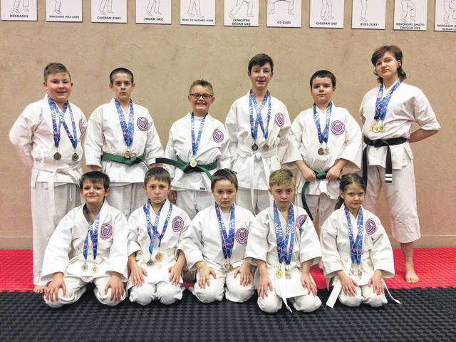Greenville's Matsunoki Martial Arts & Fitness Center traveling team competed in Carmel, Ind. From left to right, back row: Daniel Kerns, Patrick Hammaker, Christian Hanna, Samuel Kerns, Tate Richardson, and Lydia Fadden. Front row: Jaxon Gruber, Henry Ross, Liam Strunks, Colton Hanna, and Annabelle Holsapple.