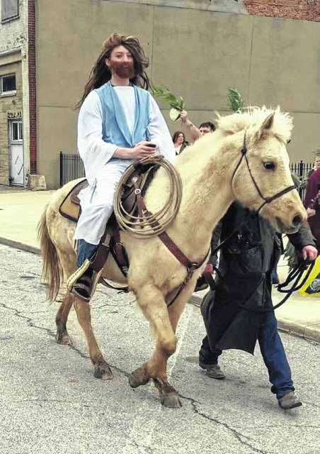 """""""Jesus,"""" portrayed by CrossRoads church youth member, Mason, is seen riding a colt through downtown Union City, Indiana."""