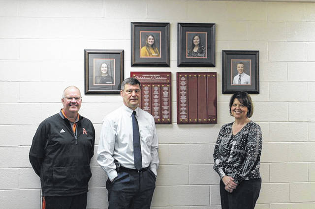 The Ansonia Academic Boosters Club hung new plaques in the main entrance of the school showcasing Ansonia's valedictorians and salutatorians dating back to 1981. Pictured left to right are Principal Jim Robson, Superintendent Jim Atchley, and Diana Walls.