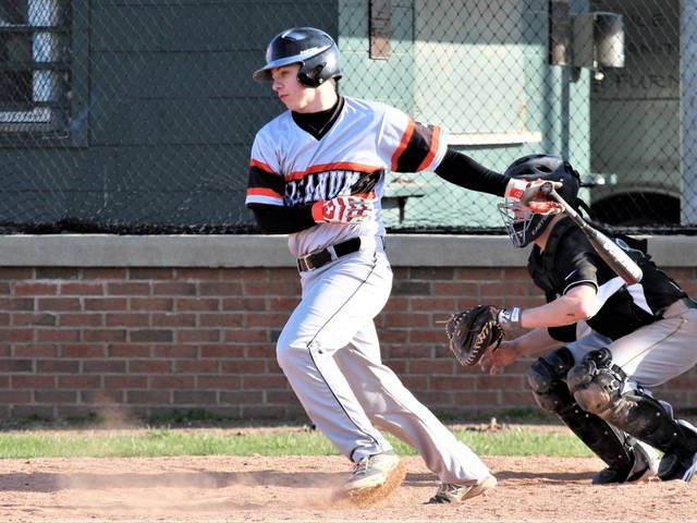 Nate Kubik collects a hit for the 2016 Arcanum Trojans at Greenville's Sater Park.