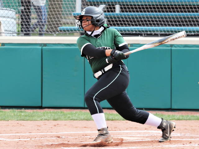 Nyesha Wright drills a lead-off home run in the Lady Wave's win over Minster.