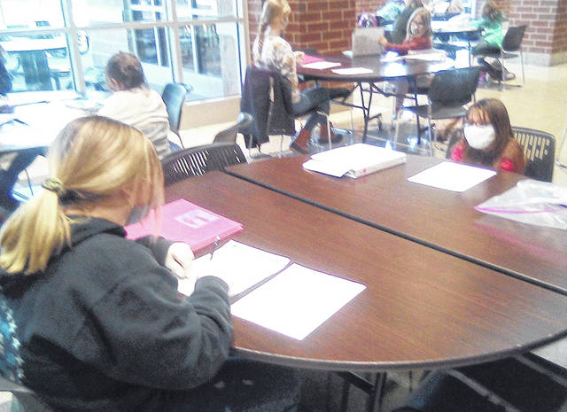 Empowering Darke County Youth will hold in-person tutoring this summer. Shown, an Edison State student works with a Greenville Elementary student in the Greenville Empowering After School Program.