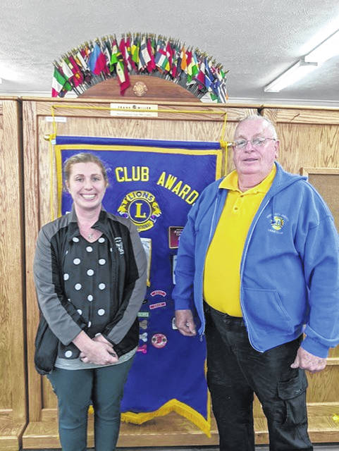 Ashley Austerman, art teacher at Mississinawa Valley schools, presented her plans for a large mural to be displayed in Union City. Pictured are (left to right): Ashley Austerman, Art Teacher at Mississinawa Valley High School and Doug LeMaster, Union City Lions Club President.