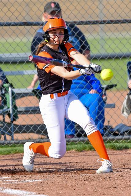 Arcanum's Reece Blinn swings away for the Lady Trojans in the team's win at Mississinawa Valley.