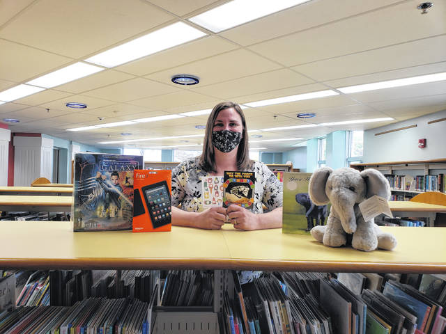 The Greenville Public Library has announced its summer reading program is back. Pictured is the Greenville Public Library Children's Librarian, Joanna Brown with a few of the prizes up for grabs during this year's Summer Reading Program.