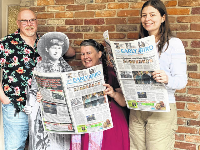 """From left to right, <em>Early Bird/Daily Advocate</em> Editor Erik Martin, """"Annie,"""" and Reporters Carol Marsh and Abigail Miller."""