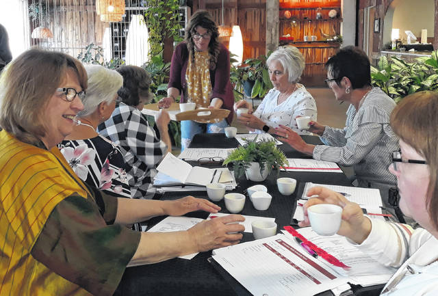 """Kim Berry (center) offers samples of her """"Indian Fire"""" blend to Greenville BPW club members (left to right) Karen Sink, Peggy Foutz, Betty Kosier, Kathy O'Dell, Pam Sharp, and Vicki Cost at the Blue Lantern Tea House, located at 106 Broadway, in Greenville."""
